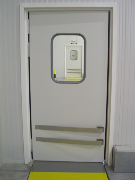 Puerta pivotante doble accion da 40 tane hermetic for Puerta industrial