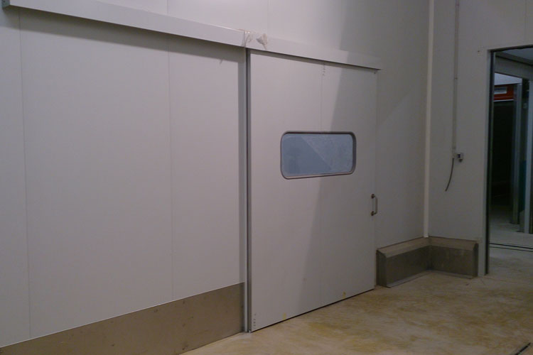 Puerta corredera industrial tc1 l nea econ mica tane for Puerta industrial